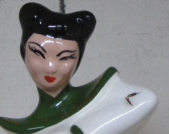 Vintage green asian girl pottery
