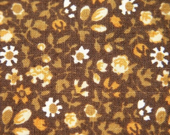 Vintage 1960s quilt fabric in highquality prewashed unused cotton with small white/orange flower pattern on dark brown bottomcolor