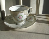 Adorable Tea Cup: Delicate Pink Flowers with Gold Rimmed Baby Nursery