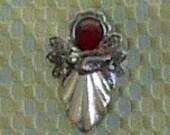 Angel Brooch with deep ruby crystal