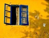 Mediterranean Summer - A Fine Art Photograph - A bright blue open window against a rustic yellow wall in Turkey