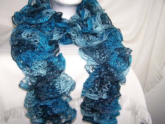 New yarn Sashay scarf special for New Years. Multicolors of blue, teal, aqua, turquoise. Soft, light weight, wavy, fashion, lacy