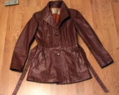 vintage petite woman's red-brown 1970's argentinian leather jacket