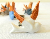 White hand painted gold winged bird ring