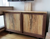 Entertainment center in a natural edge walnut.