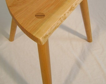 Naturalist stool made from locally harvested wild black cherry.