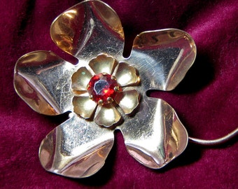 Vintage metal flower pin with stone 1940s