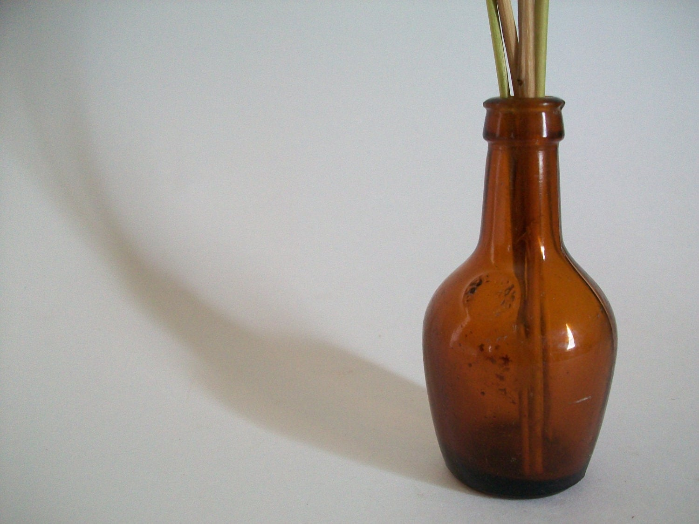 Vintage amber miniature paul jones glass bottle use for for Uses for old glass bottles