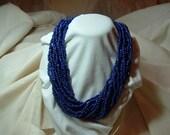 Gorgeous Blue 15 strand beaded necklace twist