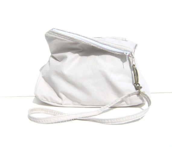 Small Purse. Clutch. Wristlet. Removable Strap. Zipper Closure. Exterior Pocket, Gadget Case.