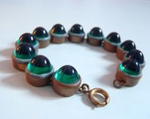 Antique Emerald Green Glass Gumdrop Cabochons and Bronze Tone Bracelet