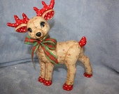 Ceramic Christmas Reindeer Softy hand painted with a Holly Berry prints to look stuffed & a plaid ribbon