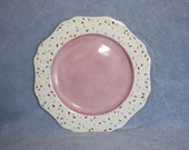 Handpainted Ceramic Festive Pink Plate with a white trim decorated in sprinkles