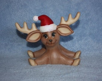 Handpainted Ceramic Calico Christmas Deer Sliding and wearing a Santa hat