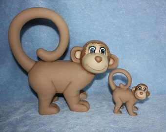Handpainted Ceramic Mommy Monkey in brown with a tan face and blue eyes