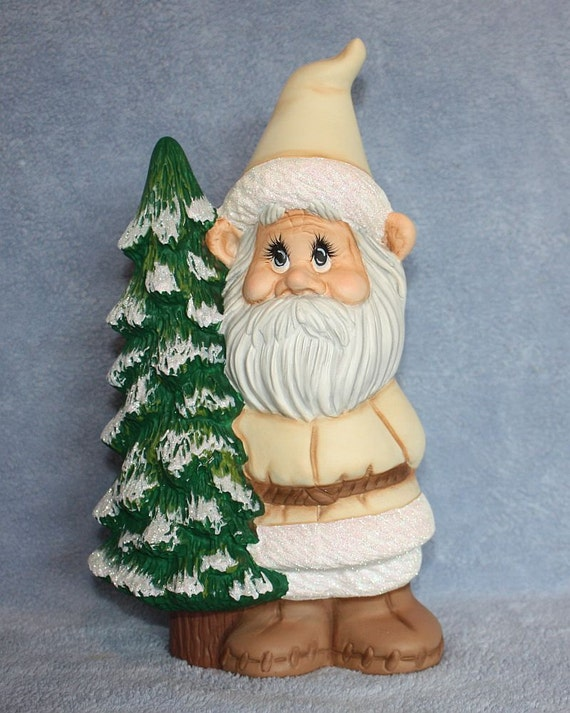 Handpainted Ceramic William Gnome in Winter White and holding on to a Pine Tree