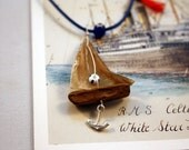 driftwood sailboat necklace with genuine parchment and sterling silver anchor with an adjustable macrame closure