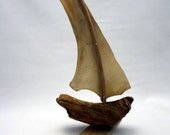 driftwood sailboat with parchment