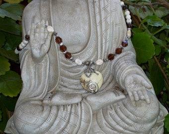 NEVADA .... White Turquoise Puffy Heart Pendant, White Turquoise Beads, Bronzite, Swarovski Crystals and Tibetan Silver Necklace