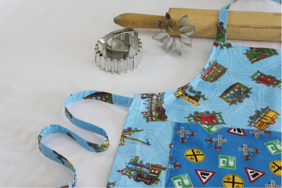 Trains Child Apron - blue with pocket