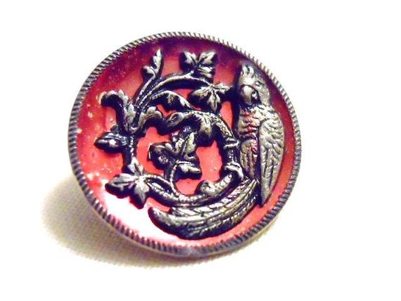 Red Tinted Metal Bird Button  Marked Eingetr Musier