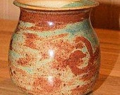 Pottery vase with rich autumn colors and green swirls