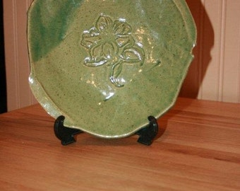 Green pottery serving plate with flower design