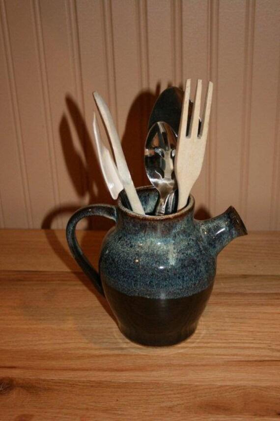 Blue pottery pitcher, utensil holder, vase, serving, entertaining, serving jug