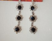 Long black flower dangle earrings