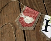 Six pendant custom burlap banner flanked with love birds