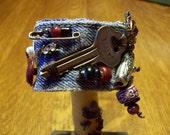 Key Wrist Cuff in denim with beads vintage key rhinestones and fob