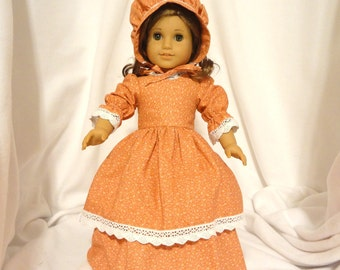 Orange cotton print, double skirted, long dress for 18 inch dolls, with ivory lace trim.