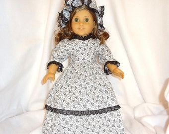 White with black print, long dress for 18 inch dolls, double-skirted with black lace trim.