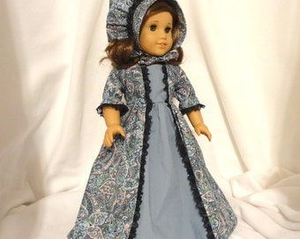 Country blue paisley, long dress for 18 inch dolls, with solid blue inset and black lace trim.