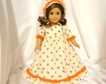 Cream floral print, long dress for 18 inch dolls, with orange lace trim.