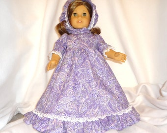 Purple, pink, green, and white paisley print, long dress for 18 inch dolls, with white lace trim.