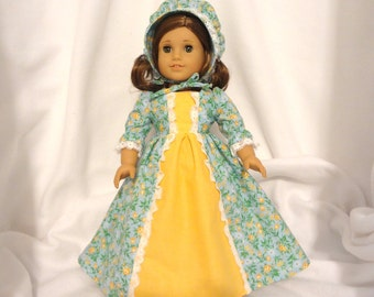 Yellow floral on light blue, long dress for 18 inch dolls, with solid yellow inset and white lace trim.