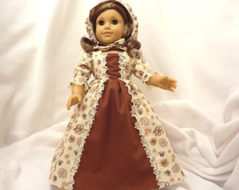 Beige, gold and brown print, long dress for 18 inch dolls, with contrasting brown inset and beige lace trim.
