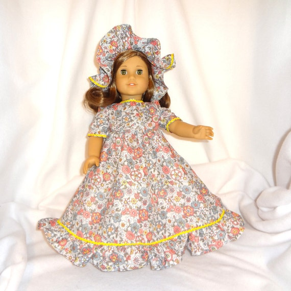 Floral print on light gray, long dress for 18 inch dolls, with yellow baby rick rack trim.
