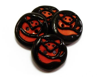 Polymer clay buttons naive art carved red foxes on black foreground set of four