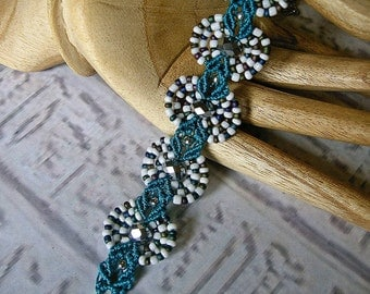 Micro macrame bracelet in teal white and silver.