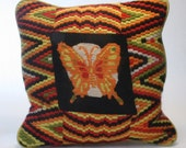 A Retro Needlepoint Handmade Pillow featuring a Butterfly  Clean, Clean, Clean, & Clean