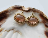 Colorado topaz. Beautiful large peachy champagne twisted rope 16k gold framed glass stone earrings