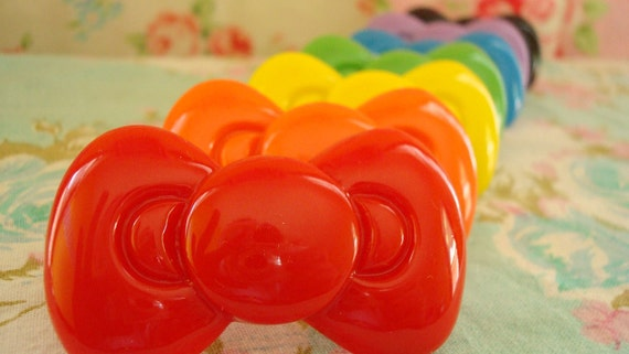 Giant Hello Kitty Solid Rainbow Colors Bow Kawaii Rings Red, Green, And Purple Ones Left