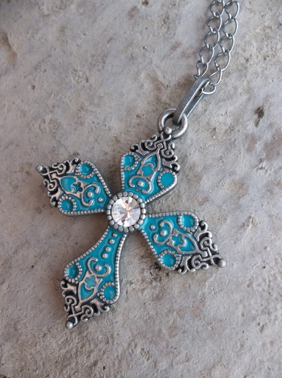 Teal Blue and Silver Filligree Metal Cross Pendant with Irredescent Crystal Center.