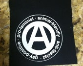 """Circle A: """"Pro-feminist, animal-friendly, anti-fascist, gay-positive"""" - Patch (off white on black)"""