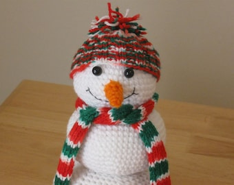 Amigurumi snowman with red and green knitted hat & scarf