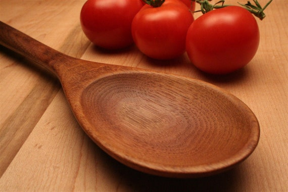 Handmade wooden spoon for stirring and tasting of Walnut wood