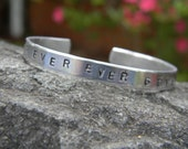 Never Ever Ever Give UP, a reminder for us all in this simple silver bangle hand stamped
