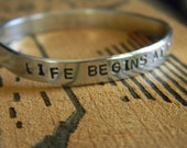 Life begins at the end of your comfort zone.  Silver hand stamped bracelet